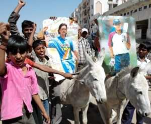 Dejected cricket fans mount portrait of Dhoni and Ganguly on a donkey and take out a procession in Ahmedabad on Saturday. (TOI Photo)